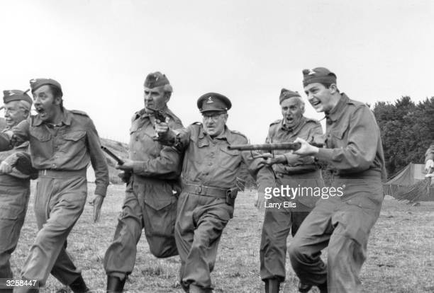 The cast of 'Dad's Army' a popular tv series depicting the activities of the Home Guard during the Second World War pose for publicity photographs...