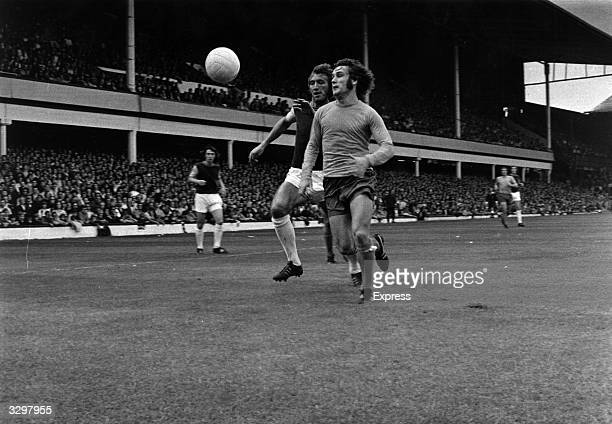 Everton's Colin Harvey and West Ham United's Billy Bonds compete for the ball