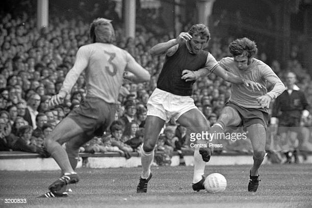 On the left West Ham's Billy Bonds fights for possession of the ball with Colin Harvey of Everton during a Ist Division match at Upton Park