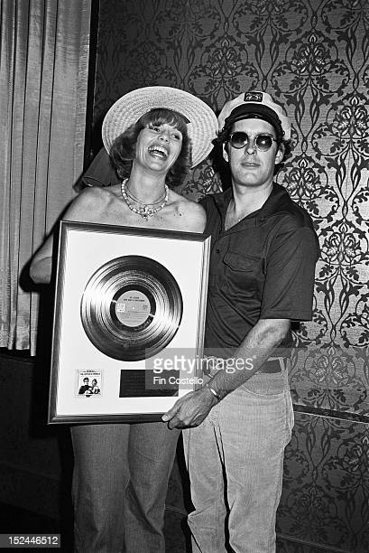 28th AUGUST: Toni Tennille and 'Captain' Daryl Dragon from American pop duo Captain & Tennille posed holding a gold disc in New Haven, Connecticut on...