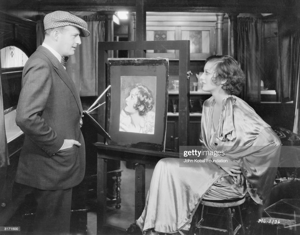 Famed artist Henry Clive painting american film actress Joan Crawford (1908 - 1977) for the cover of 'Screen Play Secrets'.