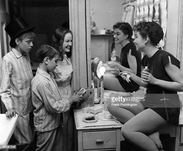 British actress Janette Scott in her dressing room with fellow cast members during a production of Peter Pan Original Publication Picture Post 8764...