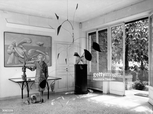 American art collector and millionairess Peggy Guggenheim in the entrance hall of her eighteenth century Venetian palace the 'Palazzo Venier dei...