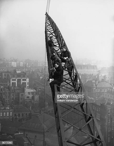 Crane workers enjoying lunch 150 ft above Berkeley Square no safety harness no hard hats just their sandwiches and the view