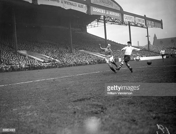 Manchester United outside right, James Delaney , in action. Delaney has been capped ten times for Scotland. Original Publication: Picture Post - 4516...