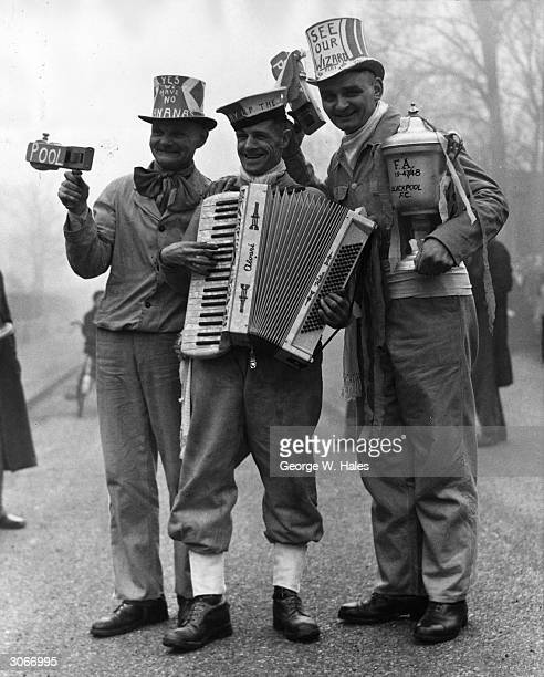 Three tophatted Blackpool supporters in London to watch their team play Fulham in a sixthround cuptie match One of them is playing an accordion