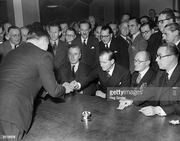 The Duke of Edinburgh takes a card at the Magic Circle headquarters To the left of the Duke is Louis Mountbatten 1st Earl Mountbatten of Burma