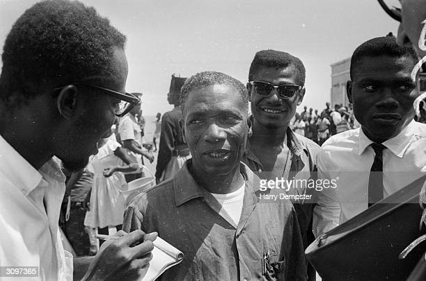 Newly released political prisoner being interviewed following the coup which ousted Kwame Nkrumah.