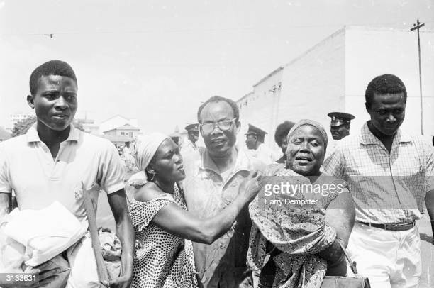 Crowds greeting a newly released political prisoner following the coup which ousted Kwame Nkrumah.