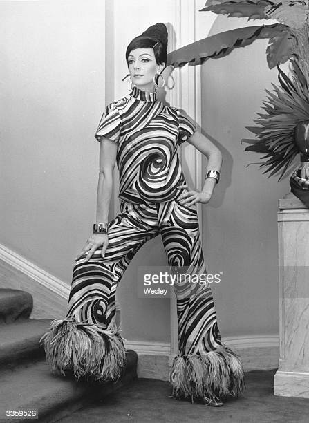 Ann Milling models a pyjama suit in printed silk, trimmed with feathers from the Christian Dior London Spring/Summeer collection.