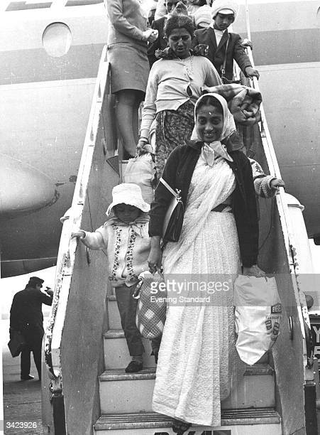 Asian immigrants disembarking on their arrival at Stansted Airport