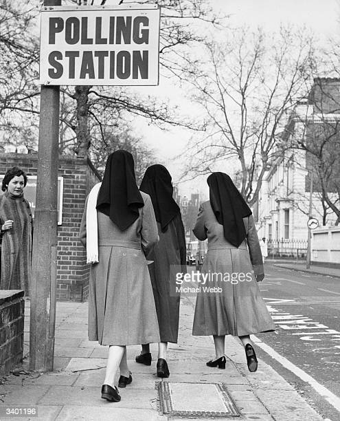 Three nuns from the Franciscan Mission of Mercy entering a polling station in The Boltons, Kensington to cast their vote at a General Election.
