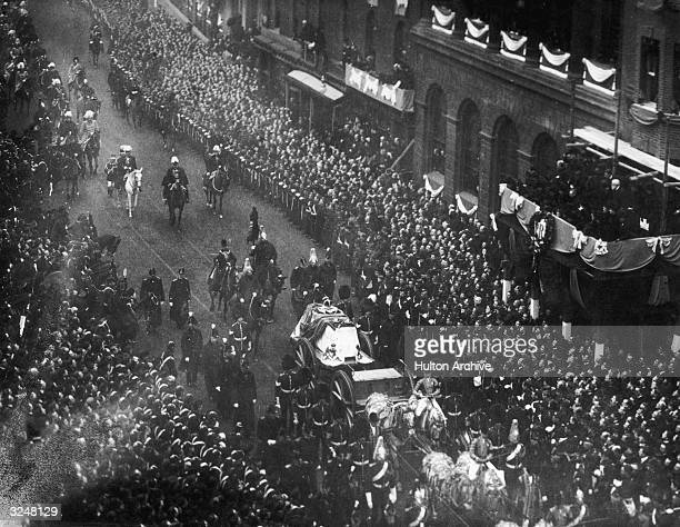 Crowds line the streets to watch the funeral cortege of Queen Victoria