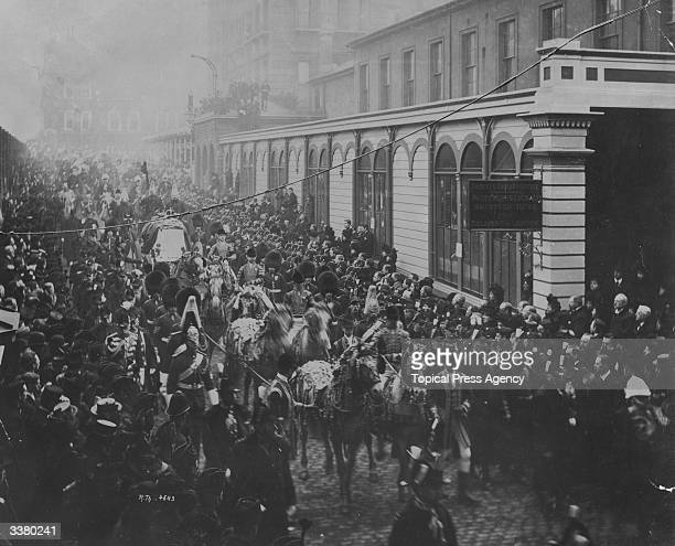 Crowds lining a London street as Queen Victoria's funeral cortege passes