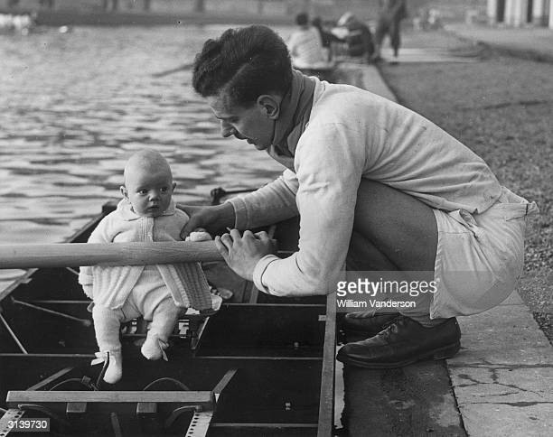 3 month old Andrew Mellows gets some rowing instruction from his father on the River Cam The baby's father is part of Cambridge University's rowing...