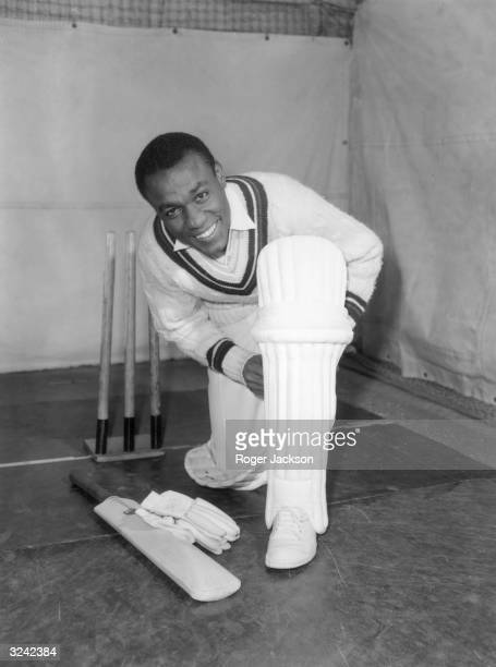 West Indies cricketer Conrad Hunte padding up for some batting practice at Alf Glover's Cricket School, London.