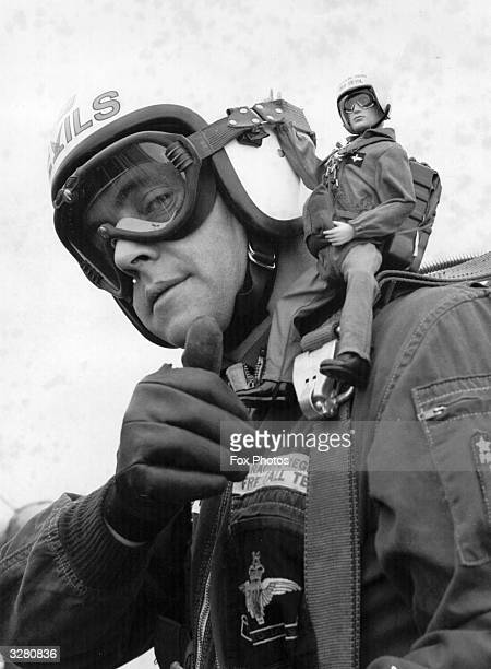 A toy Action Man on the shoulder of a real member of the 'Red Devils'