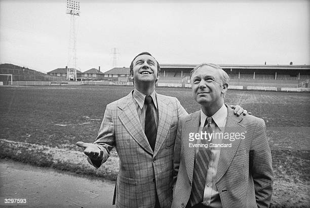 Leeds United manager Jimmy Armfield with his arm round Wimbledon manager Allen Batsford at Wimbledon's very wet Plough Lane ground