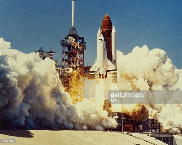 The space shuttle Challenger takes off from the Kennedy Space Centre Florida 73 seconds later the shuttle exploded killing its seven crew members