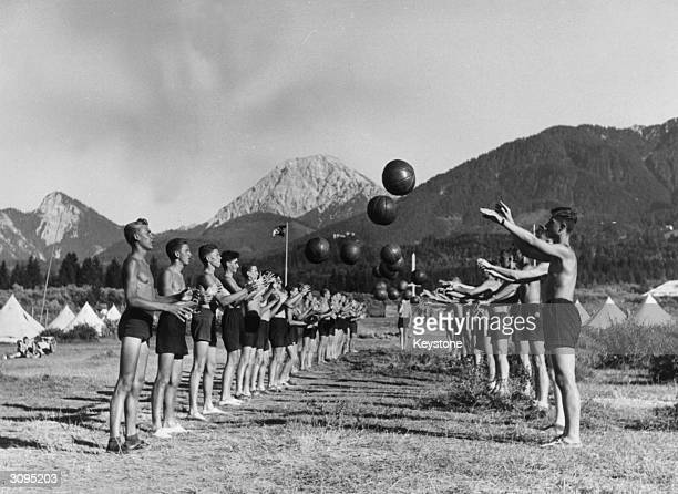 Hitler youths playing with medicine balls at the Wilhelm Gustloff Camp on the edge of the Faaker Lake in Austria
