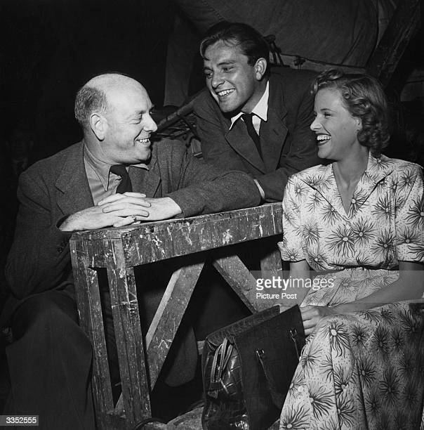 Producer John Gossage laughing with actors Richard Burton and Honor Blackman on the set of the film 'Green Grow The Rushes' directed by Derek N Twist...