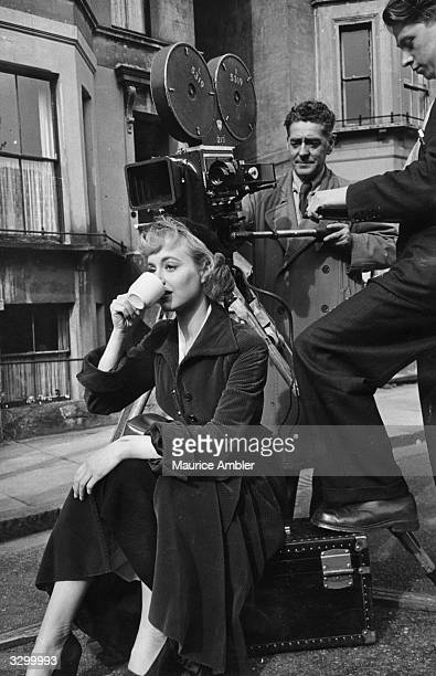 British actress Pauline Stroud drinking a cup of tea between shots during the British Lion production of 'Lady Godiva Rides Again' on location at...