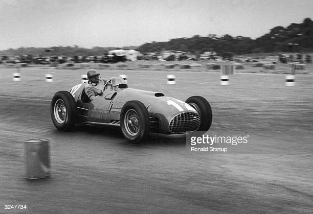 Froilan Gonzalez in his Ferrari 375 on his way to victory in the British Grand Prix at Silverstone. Original Publication: Picture Post - 5370 - BRM...