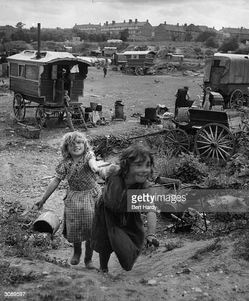 Gypsy children play in squalid and overcrowded encampment at Corke's Meadow Kent Original Publication Picture Post 5363 The Unromantic Gypsies pub...
