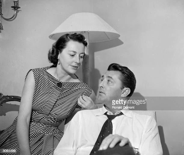 American actor Robert Mitchum in London with his wife Dorothy