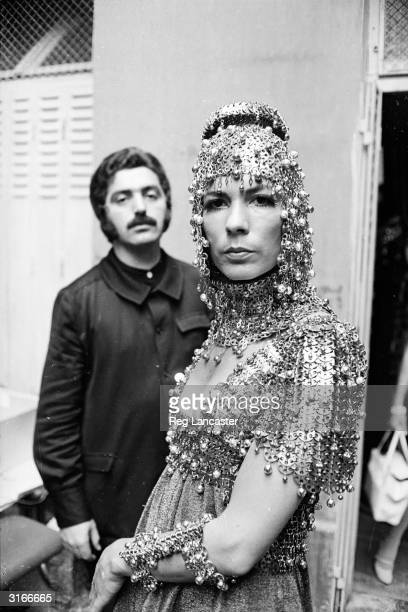 Spanish fashion designer Paco Rabanne with model Isabel Feldel who is wearing one of his elaborate metallic creations