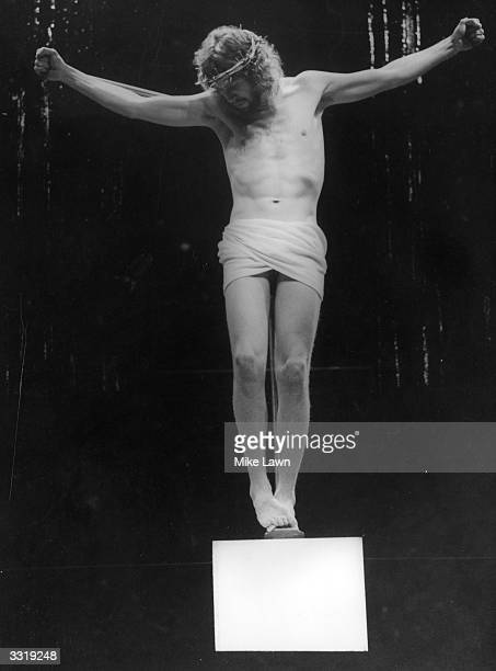 British actor Paul Nicholas in crucifix pose playing the title role in Jim Sharmah's production of 'Jesus Christ Superstar' at the Palace Theatre.