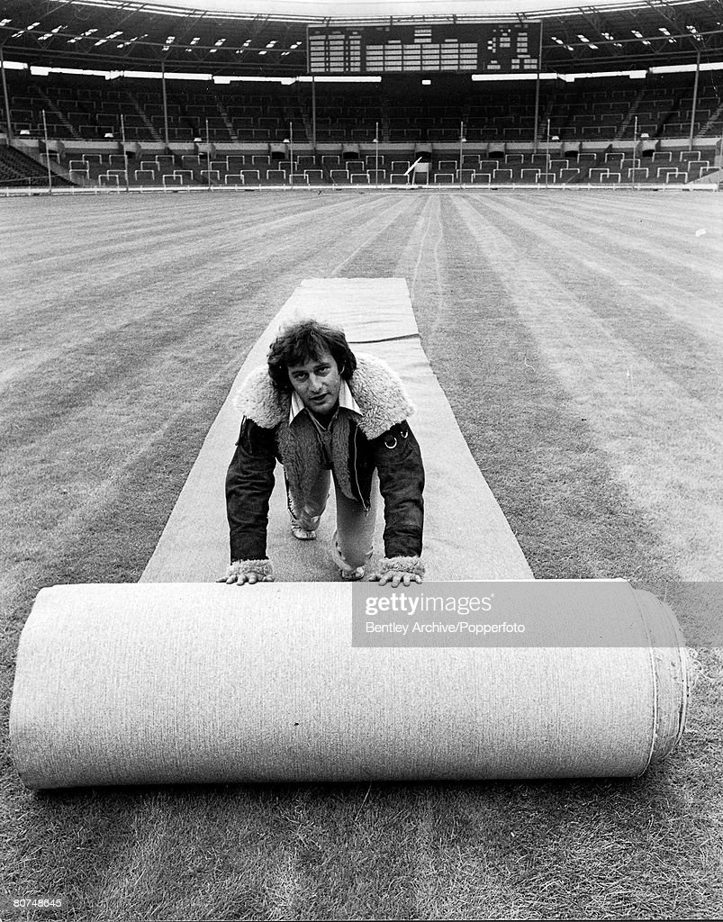28th July 1972 London, England. Rolling out the carpet at Wembley Stadium, the organisers of an all-star rock'n roll concert to be held there shortly, want to protect the famous pitch. : News Photo
