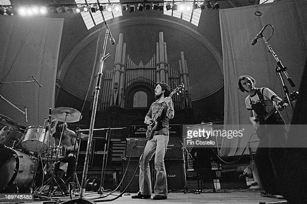 Welsh group Man perform live on stage at Alexandra Palace Festival in London on 28th July 1973 Left to right drummer Terry Williams guitarist Micky...