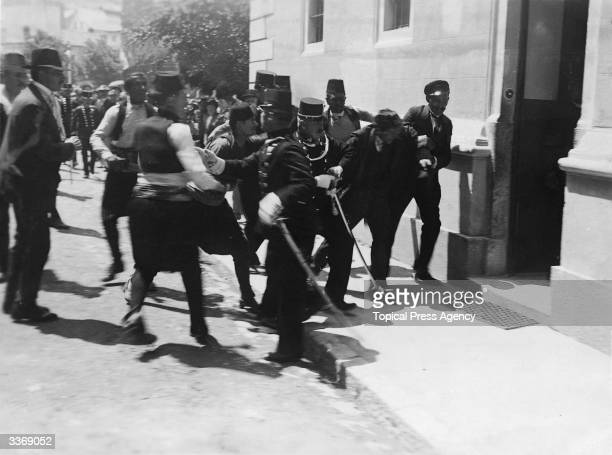 Police in Sarajevo arrest a man after a failed assassination attempt on the life of Archduke Franz Ferdinand heir to the throne of the...