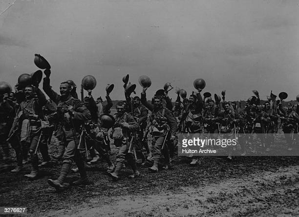 Soldiers from the 1st Battalion of the Worcestershire regiment marching to the trenches their helmets raised high