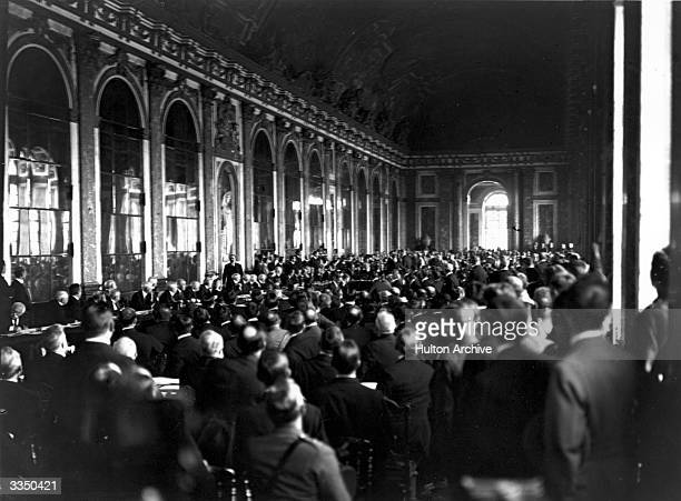 Diplomats and delegates watching the signing of the Peace Treaty of Versailles in the Hall of Mirrors at Versailles in France