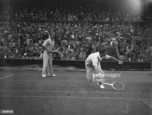 American doubles partners Donald Budge and Gene Mako in action during their match against the Jean Borotra and Jacques Brugnon of France at the...