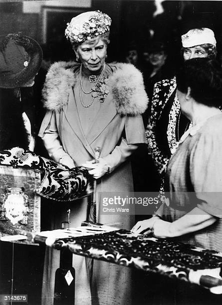 Queen Mary with Lady Dorien at an exhibition of needlework at the Royal School of Needlework in Exhibition Road London