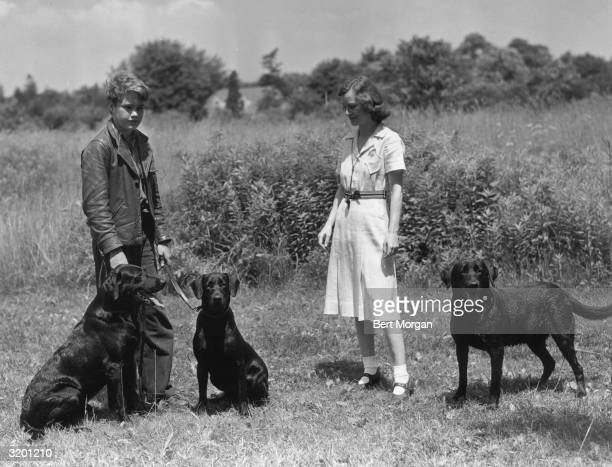EXCLUSIVE LR Peter Potter and Kathleen B Starr of Islip Long Island stand in a farm field with three Labrador retrievers Potter was the son of dancer...