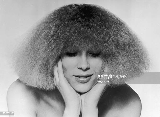 The 'Electric Cut' invented by Paris hair stylist Patrick Ales The hair is given body by ultra overcurling then straightened and cut into a shoulder...