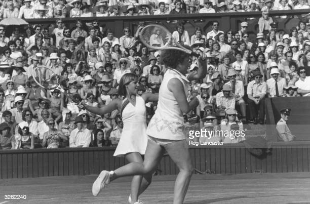 Chris Evert and Martina Navratilova in action together on the doubles court at the Wimbledon Tennis championships where they beat Billie Jean King...