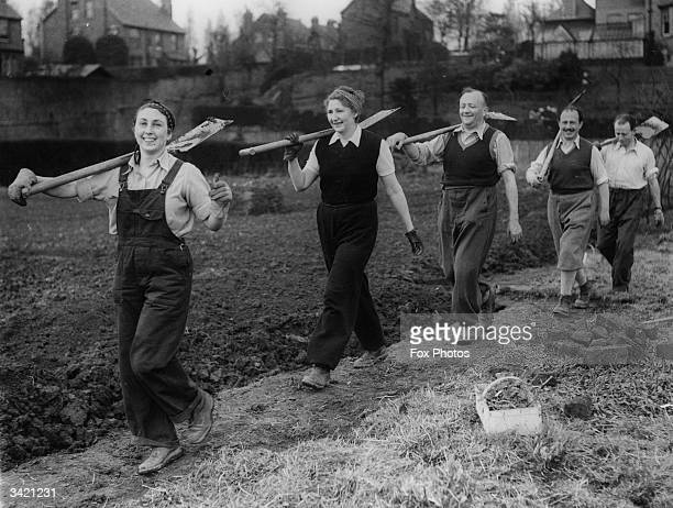 Austrian refugees off to work on an allotment at West Didsbury, Manchester during WW II.