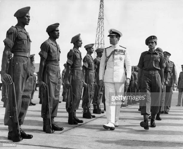 Lord Louis Mountbatten 1st Earl Mountbatten of Burma takes the salute from the Governor General's bodyguard at Viceroy House in New Delhi as he takes...