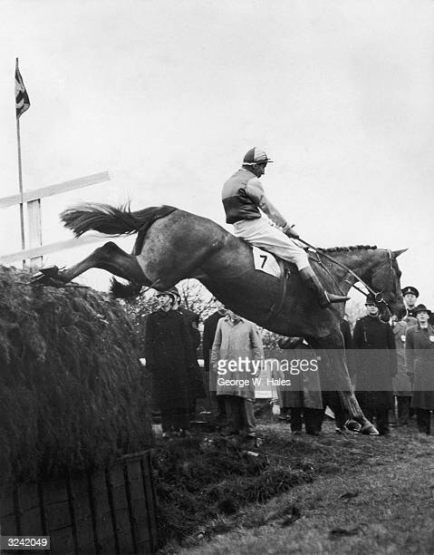 Bryan Marshall rides G H Griffin's Early Mist over Becher's Brook at Aintree, eventually winning the Grand National with a lead of 20 lengths.