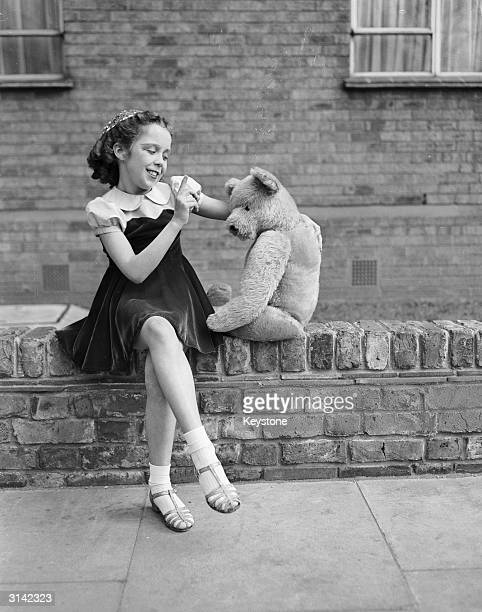 11yearold Mary Forrester of Portsmouth rehearsing her 'Don't Worry' act with her teddy bear before competing in London Musical Festival's Stage...