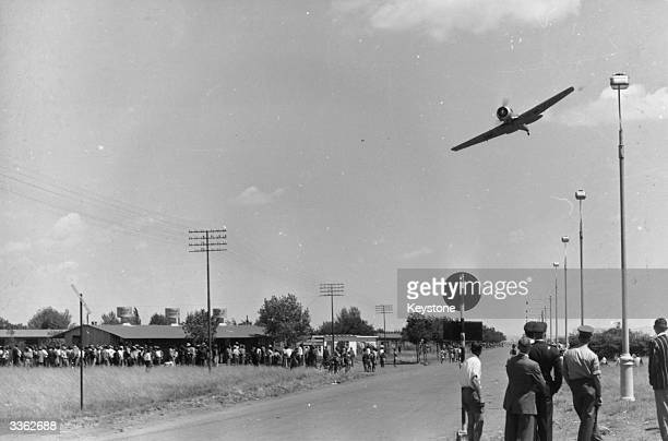 A South African Airforce plane flies low over Africans at Sharpeville in an attempt to frighten villagers protesting at a rule which forces them to...