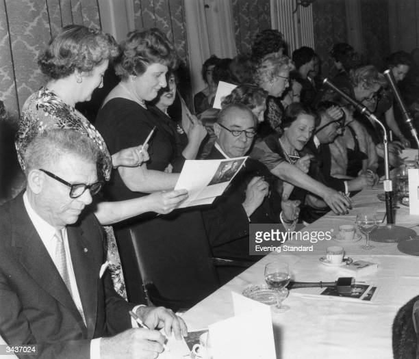 Women fans queuing for the autographs of composer Richard Rodgers and librettist Oscar Hammerstein at a dinner Oscar Hammerstein is first on the left
