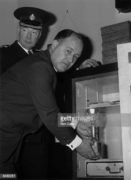 Chief Detective Superintendent John Baily placing the World Cup in the safe at Cannon Row police station after its successful recovery following its...