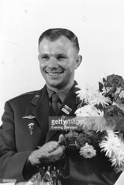 Russian cosmonaut Yuri Alekseyevich Gagarin holding a bouquet of flowers