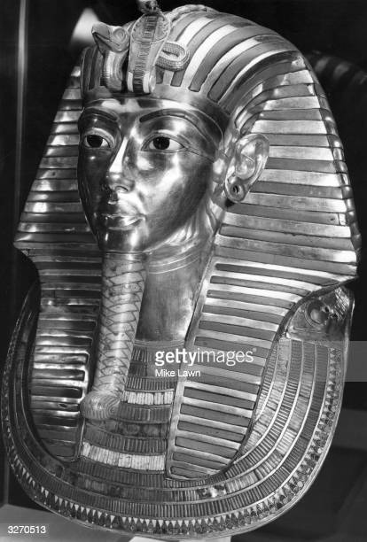 The gold mask placed over the head of the mummy of Tutankhamen, buried in his tomb at Thebes in the Valley of the Kings is displayed at the...